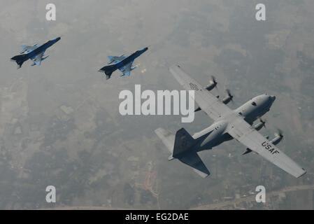 Two Bangladesh Air Force F-7BG Defenders from 5th Squadron, BAF Base Bangabandhu, escort a U.S. C-130H Hercules - Stock Photo