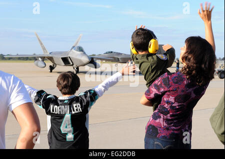 Family members wave to returning service members of the 27th Fighter Squadron Oct. 18, 2013, at Langley Air Force - Stock Photo