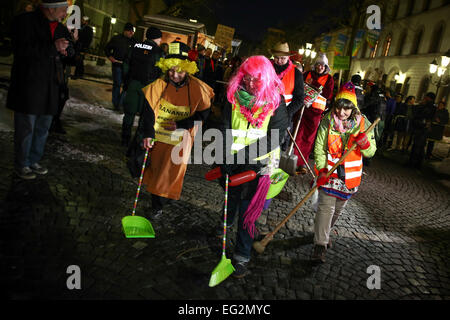 Wunsiedel, Germany. 14th Feb, 2015. Citizens in colorful carnival revelry protest against a neo-Nazi demonstration - Stock Photo