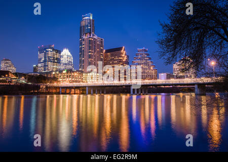 A night view of the skyline of Austin, Texas, USA taken from the south shore of Lady Bird Lake. - Stock Photo