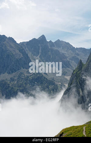 View from Col du Tourmalet (2215m), Pyrenees, Hautes Pyrenees (France) in a foggy day. - Stock Photo