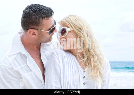 portrait of young nice couple having good time on the beach eg2ynj