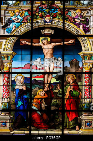 Beautiful stained glass window created by F. Zettler (1878-1911) at the German Church (St. Gertrude's church) in - Stock Photo