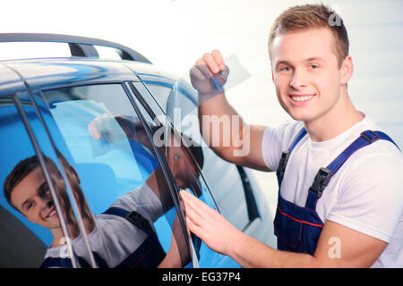 Car wrapping specialist in the station - Stock Photo