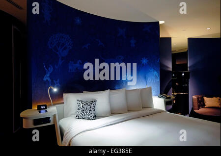Bedroom in the luxurious Sofitel So hotel in the city of Bangkok in Thailand - Stock Photo