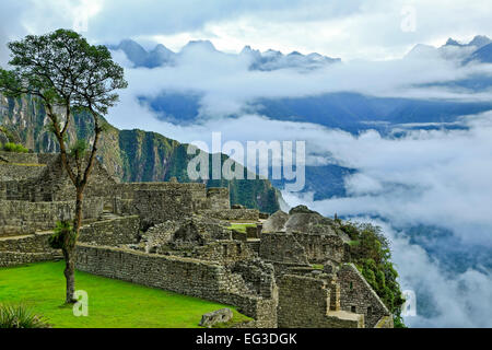 Low clouds over mountains, stone buildings, Machu Picchu Inca ruins, near Aguas Calientes, aka Machu Picchu Pueblo, - Stock Photo