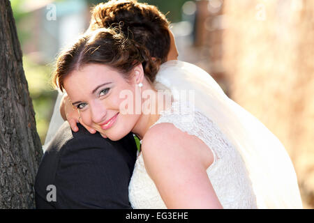 Young couple after wedding in a hug - Stock Photo