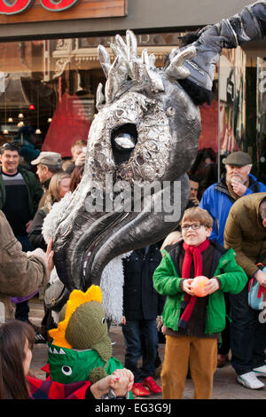 Blackpool, UK. 15th Feb, 2015. Close-Act Theatre is an international street theatre company using costumed Velociraptor - Stock Photo