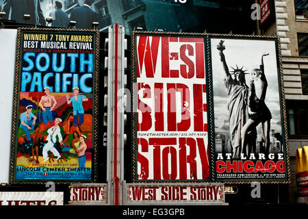Broadway musical ads for shows, along 42nd Street at Times Square. Advertising billboard sign. Theater district. - Stock Photo