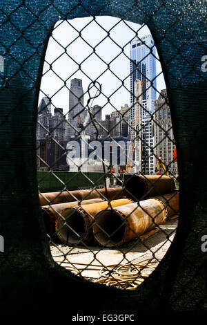 Building One World Trade Center. Looking through the fence onto reconstruction work at ground zero, Manhattan, New - Stock Photo