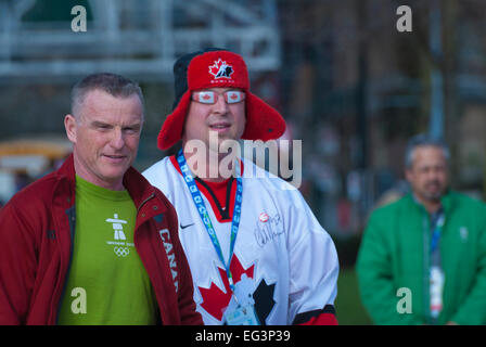 Vancouver, Canada-Feb,25,2010: Team Canada fans going to stadium during 2010 Winter Olympic Games. - Stock Photo