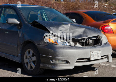 Compact car with frontal collision damage - Maryland USA - Stock Photo