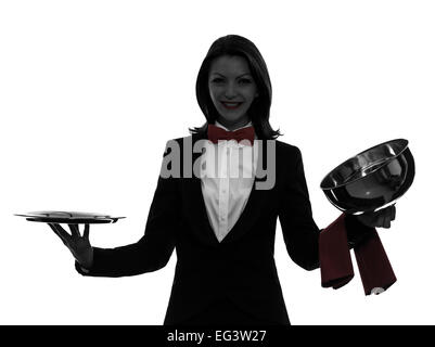 one  woman waiter butler opening catering dome in silhouette on white background - Stock Photo