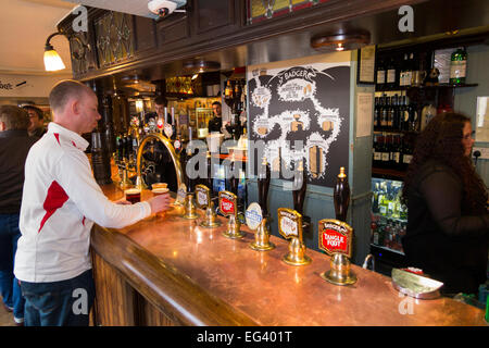 Rugby fan at bar inside The Eel Pie pub / public house / tavern. Church St. Twickenham UK; popular with Rugby fans - Stock Photo