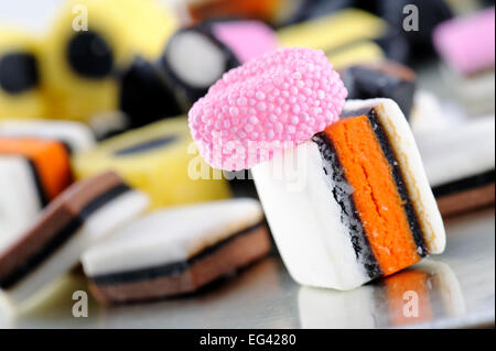 colorful liquorice candies on tray - Stock Photo
