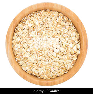 Rolled oats in wooden bowl isolated on white background. - Stock Photo