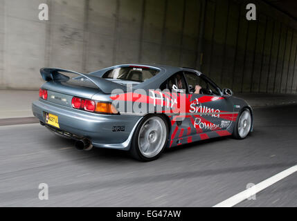 Heavily modified Toyota MR2 sports car driving - Stock Photo