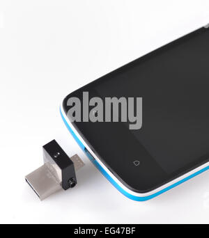 USB flashes drive ss 3.0 and mobile phone on white - Stock Photo