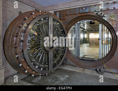 Huge bank vault door in a disused Bank - Stock Photo