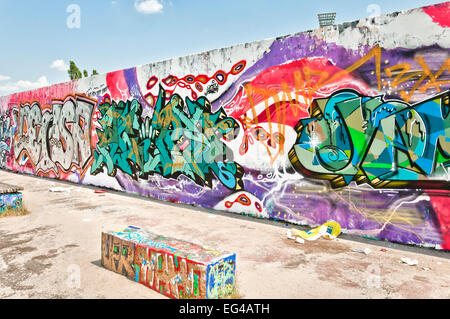 graffiti on Mauerpark wall in Berlin, Germany. A former part of the Berlin Wall death strip. - Stock Photo