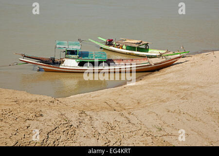 Two traditional longtail motor boats in the Irrawaddy River / Ayeyarwady River, Magwe Region, Myanmar / Burma - Stock Photo