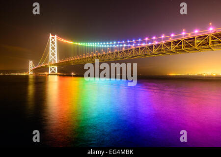 Rainbow lights on Akashi Ohashi (Pearl Bridge) in Kobe, Japan. - Stock Photo