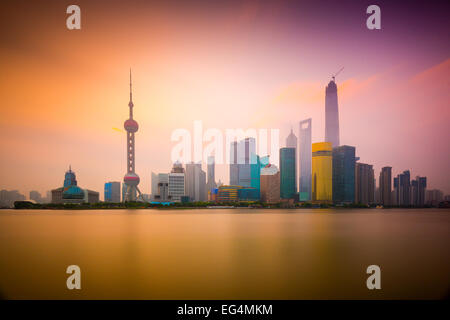 Shanghai, China cityscape viewed across the Huangpu River at dawn. - Stock Photo
