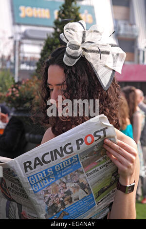 Studying form on Ladies Day / Grand National meeting / Aintree Racecourse / Liverpool / Merseyside / UK - Stock Photo