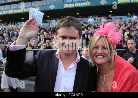 Delighted holders of a winning betting slip / Ladies Day / Grand National meeting / Aintree / Liverpool / Merseyside - Stock Photo