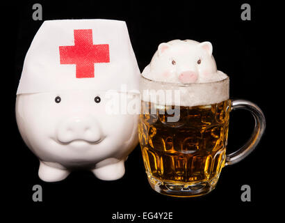 drowning in debt from drinking piggy bank cutout - Stock Photo