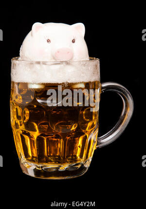 drowning in debt from drinking cutout - Stock Photo