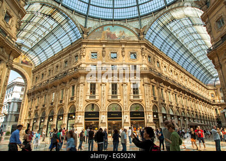 Atrium, shops and shoppers, Galleria Vittorio Emanuele, Milan, Italy - Stock Photo