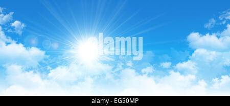 High resolution blue sky background. The sun breaking through white clouds - Stock Photo