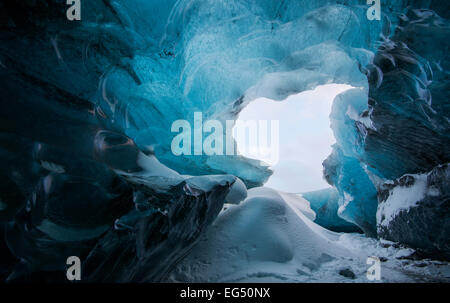 Inside a glacier ice cave in South East Iceland. - Stock Photo