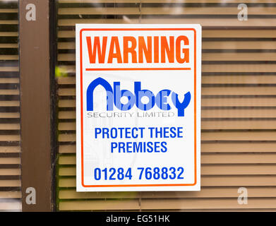 security company sign on building - Stock Photo