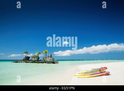 white beach and christian shrine and paddle boats on boracay tropical island in philippines asia - Stock Photo