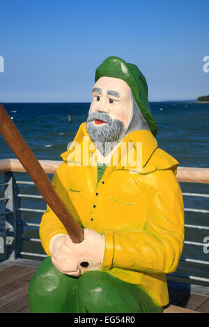 Wooden fishermen statue on the new pier in  Niendorf, Baltic Sea coast, Schleswig-Holstein, Germany, Europe - Stock Photo