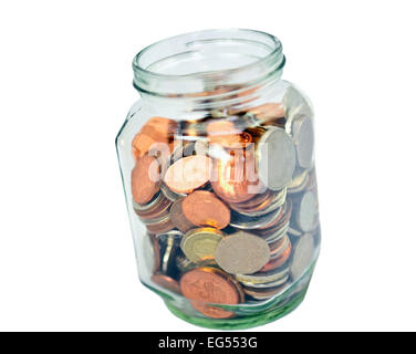 cut out of Glass jar full of uk British coins on white background - Stock Photo