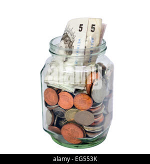 cut out of Glass jar full of uk British coins and banknotes on white background - Stock Photo