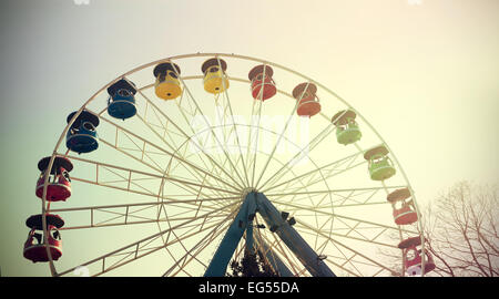Retro vintage filtered picture of a ferris wheel. - Stock Photo