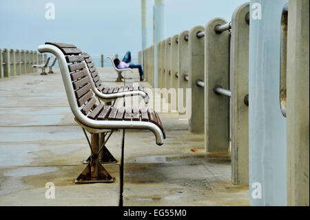Weathered stainless steel benches on New Pier Durban beachfront South Africa Travel destinations furniture sea structure - Stock Photo