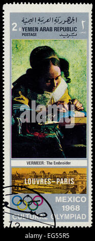YEMEN ARAB REPUBLIC - CIRCA 1968: A stamp printed in Yemen Arab Republic shows The Embroider by Vermeer, circa 1968 - Stock Photo