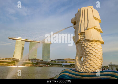 The Merlion and the Marina Bay Sands Hotel in Singapore - Stock Photo