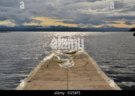 Stone Pier in a little town at Lake Titicaca between Bolivia and Peru - Stock Photo