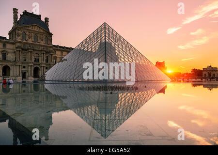 Paris, Louvre pyramid at sunset - Stock Photo
