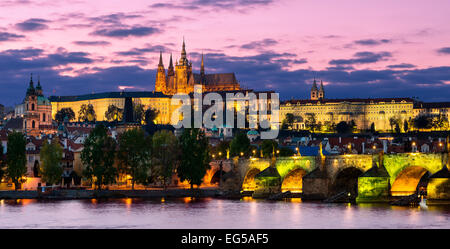 Prague, The castle and Vltava river at night - Stock Photo