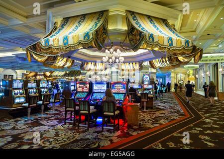 Bellagio Hotel, People playing slot machines - Stock Photo