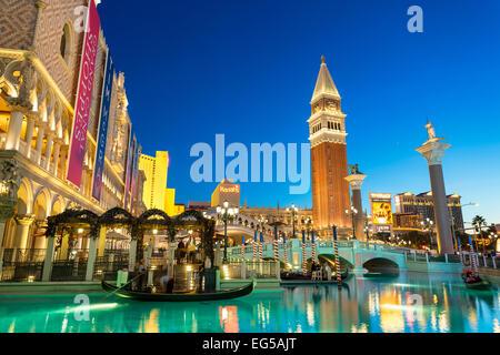 Tourists Taking Gondola Ride at The Venetian Hotel - Stock Photo
