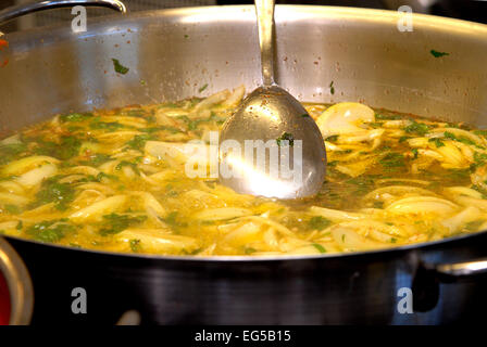 Marche , Ascoli Piceno , San Benedetto del Tronto , Fish Soup Sanbenedettese , cooking cuttlefish. - Stock Photo