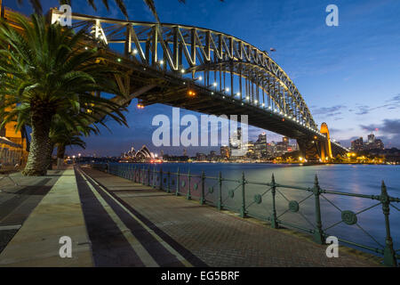 SYDNEY, AUSTRALIA- JANUARY 5, 2015: The iconic Sydney Harbour Bridge with Sydney Opera House in the background at - Stock Photo